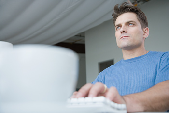 Man at keyboard.