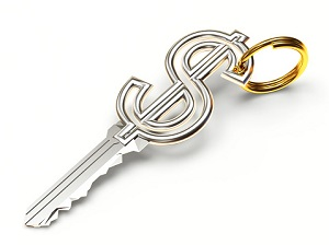 Silver key in the form of a dollar sign