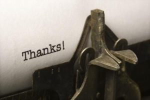 """Typewriter with the word """"Thanks!"""" on the paper."""