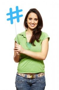 Woman holding a hashtag sign.