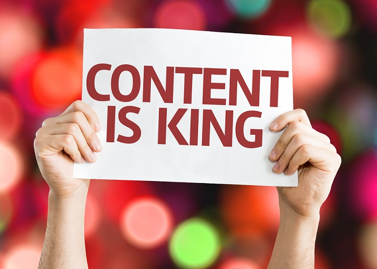 "imagine of sign which reads ""content is king"""