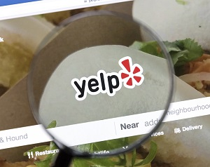 Yelp website under a magnifying glass.