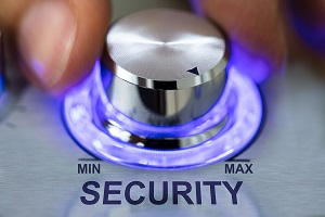 Image of hand turning metallic illuminated knob by security text