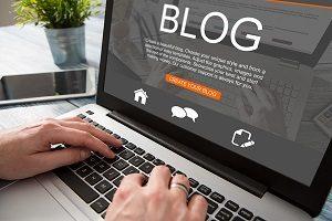 Blog writing on laptop.