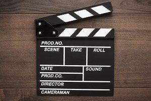 Clapper board on wood background.