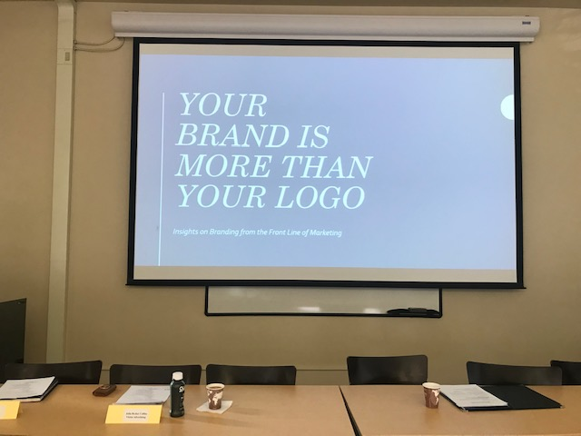 Slideshow and conference table at Clark University from our brand marketing workshop.