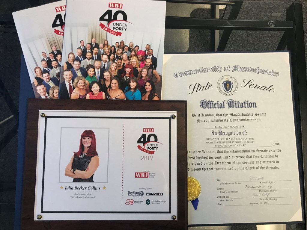 Collection of awards and collateral from 40 Under Forty program.