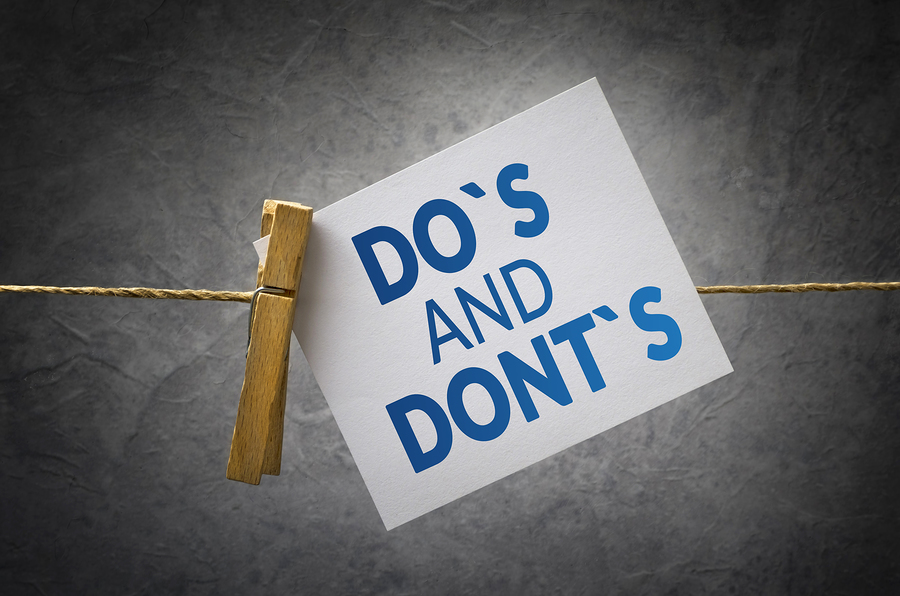 "A card reading ""Do's and Don'ts"" clothe-pinned to a string."