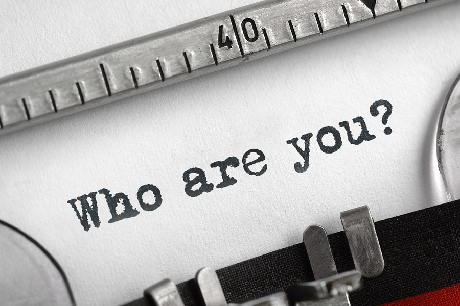 """Who are you?"" typed onto a pblank page using a typewriter"